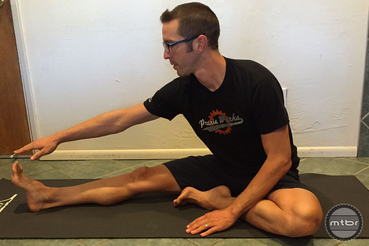Hamstrings stretch sitting on the floor.