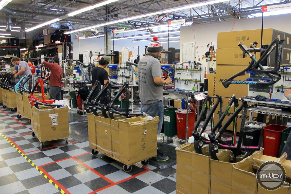 Santa Cruz bikes, taking their first steps of the build process: suspension assembly.