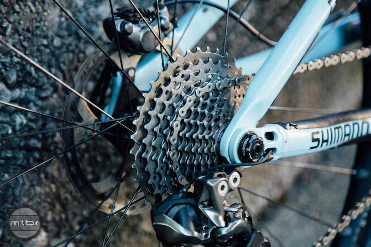 Most Shimano sponsored EWS racers that use a 1x drivetrain utilize a 11-41 XT cassette rather than the lighter 11-40 XTR. Because Tracy is running a FD, she can make do with the smaller range of the XTR cassette.
