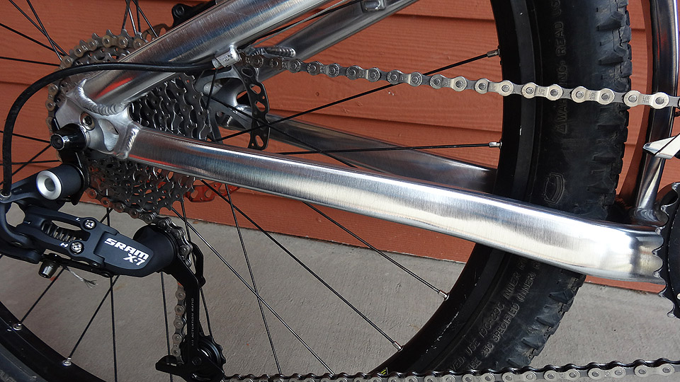 Stripping my Giant Trance X1 Frameset to bare, polished aluminum.-trancesalerightchainstay.jpg