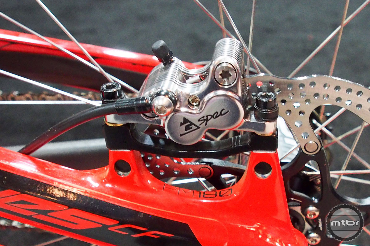 Fins were added to the caliper to create more surface area, thus dissipating heat more efficiently.