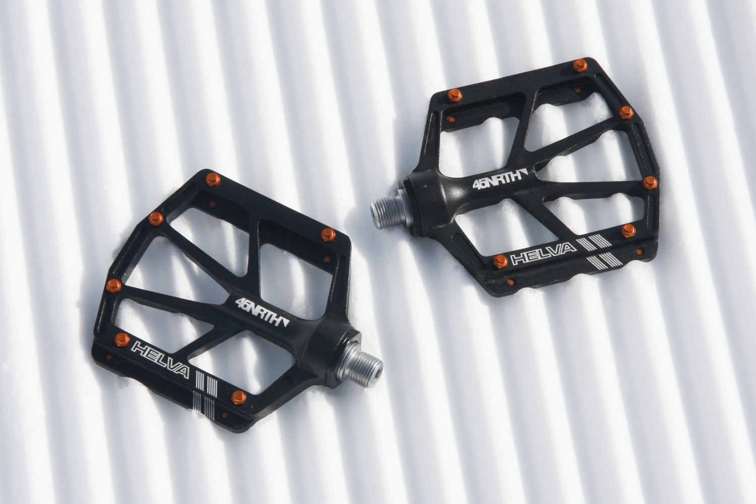 A narrow profile, six pins per side, and an open design make the 45NRTH Helva Snowshed Winter Pedals a great option for riding when snowflakes are flying. Photo by Jason Sumner