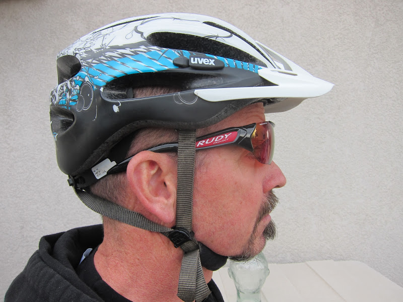 uvex xp cc helmet- side viewpoint, showing extended visor, extended rear coverage, replaceable strap toggles and large vents