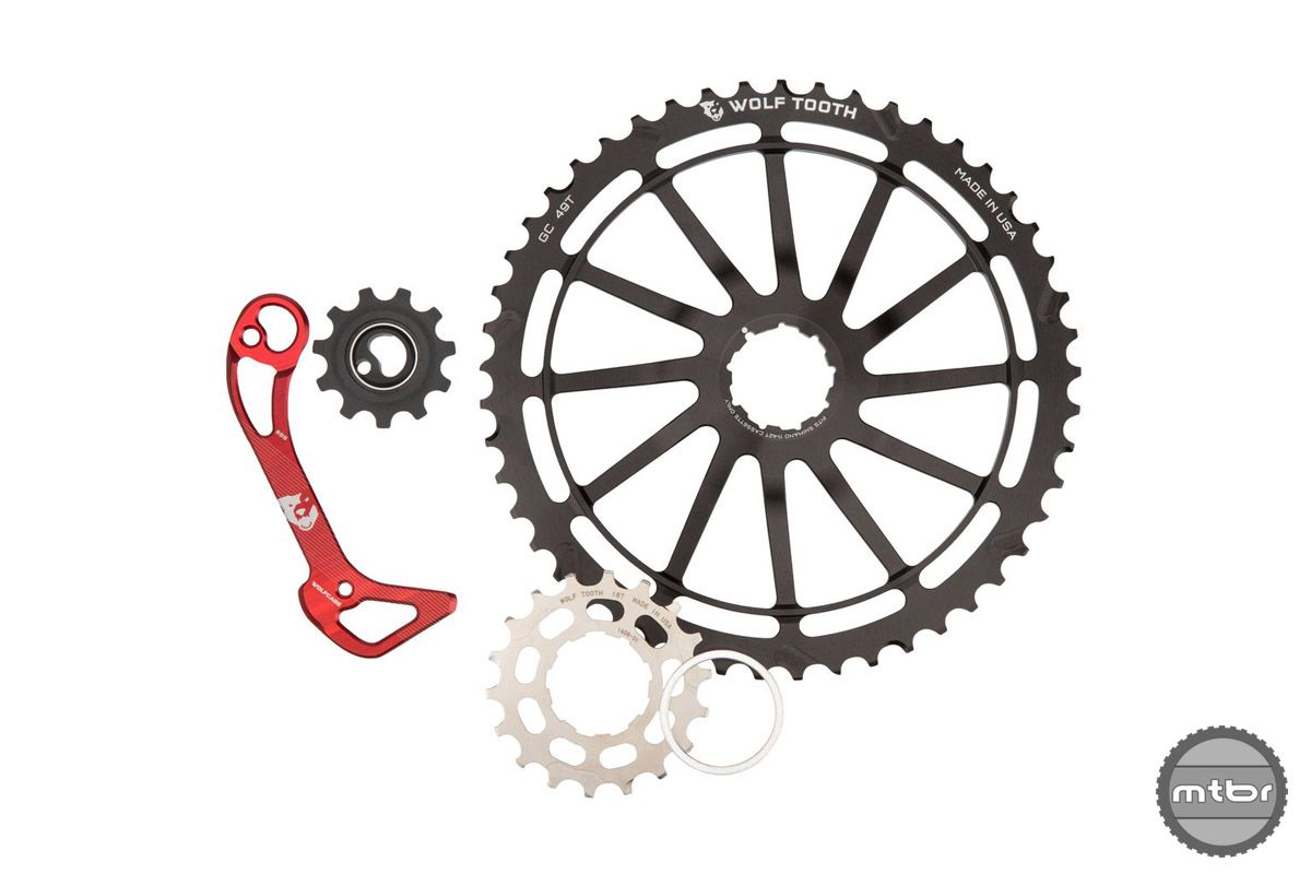 Standard 11 speed SRAM derailleurs will easily clear the GC49t cog, but Shimano users will need to purchase a new cage.