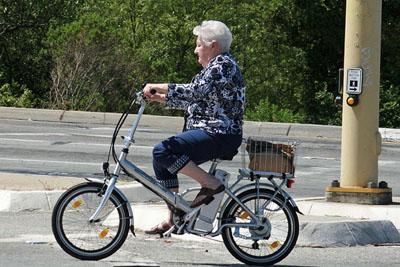 Name:  woman-on-electric-bike.jpg Views: 309 Size:  42.5 KB