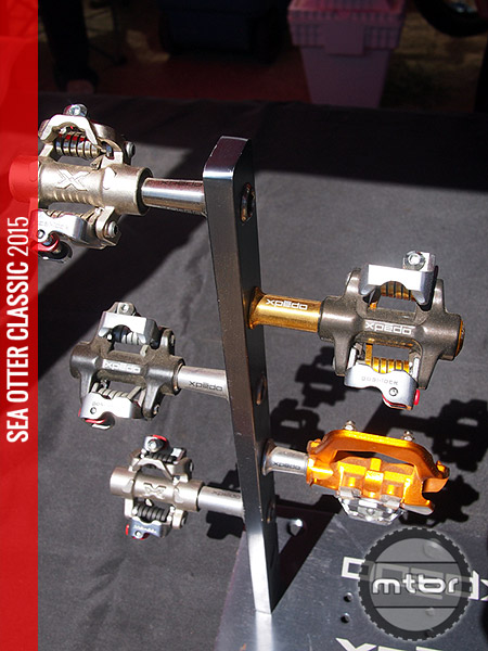 The M-Force 8 Ti (on the left) is Xpedo's flagship clipless pedal with a Ti body and Ti spindle and weight of 215 grams and a retail of $269.
