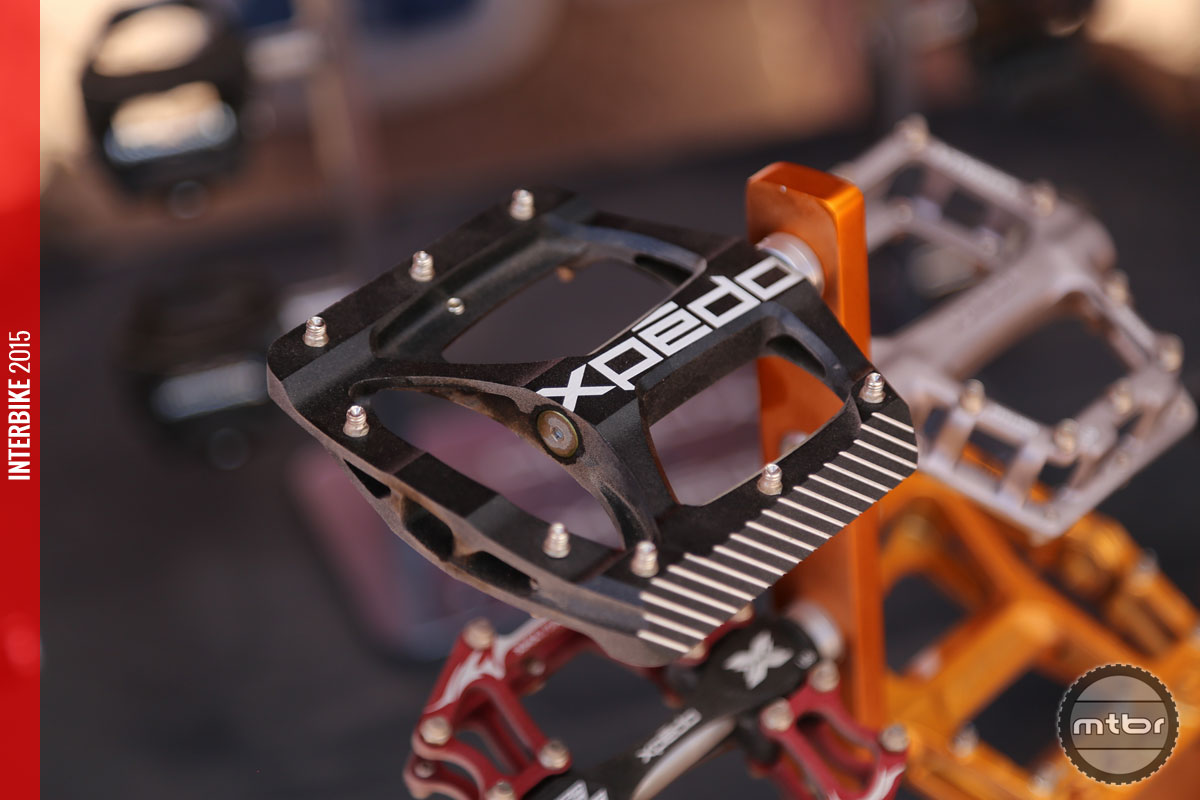The new Xpedo ZED pedal utilizes 8 removable pins per side for traction.